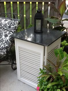WOW! old shutters and apiece of scrap granite make a great outdoor table!  | Great Lakes Stoneworks is one of the areas finest fabricators of granite marble! They do fabrication and installation of granite, marble, quartz, silestone! Call (586) 294-7930 or visit www.glstoneworks.com for more information!