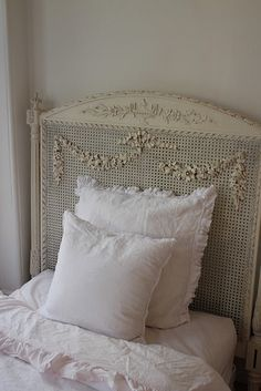 Such details on this old headboard!!  Was redone for a girl's bedroom--pretty!