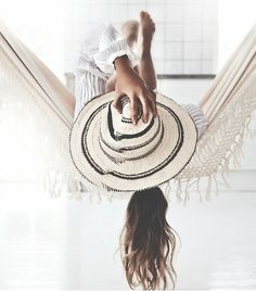 @Who What Wear - We really can't ask for much more than a straw hat and a hammock.  ​Image via Victona