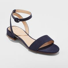 For a perfect finishing touch to any look, slip into the Winona Quarter  Strap Sandal from A New Day™. The clean lines of these sleek, sophisticated  sandals ...