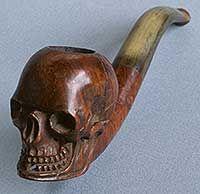 Moderne bruyèrepijp met ketel in de vorm van een doodshoofd, de steel van buffelhoorn. Frankrijk, Saint-Claude, 1900-1915.