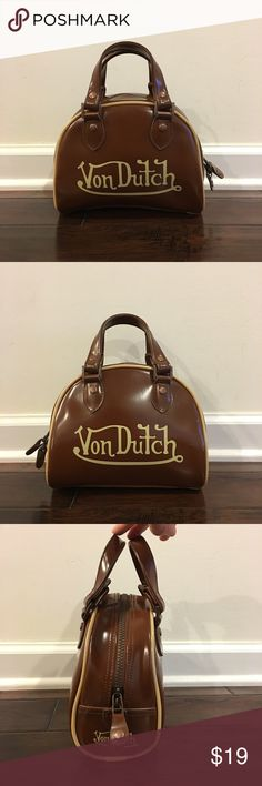 "Vintage Von Dutch Brown Satchel Handbag - Size S Vintage Von Dutch Brown Satchel Handbag - Size Small Exterior have normal sign of use, in Very Good Condition Interior have some ink stains and a small damage (photo 8) - not really can see when you open Strap drop is Very Good Condition - 2.75inch Dimension: L7.75""xW2.75""xH6.75""   Closure: Zipper Made in China Super Cute Vintage Von Dutch Handbag Von Dutch Bags Satchels"