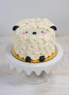 Mini Animal Cakes | Whipped Bakeshop. Cutest sheep cake ever. So cute for a first birthday cake or even a smash cake for a photo shoot.