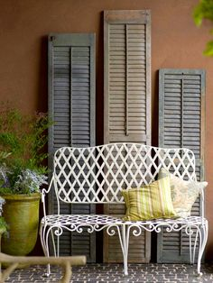 Salvaged Shutters-Add a sense of history to any space by using old building materials in new ways. Salvaged shutters are the perfect way to add interest and texture to a wall. Prop up large shutters behind a piece of furniture, or secure them to the walls Vintage Shutters, Old Shutters, Repurposed Shutters, Wooden Shutters, Window Shutters, Window Frames, Vintage Wall Art, Vintage Walls, Sweet Home