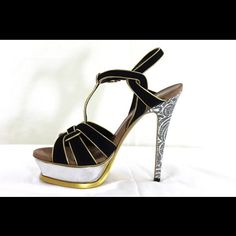 "YSL Tribute in Black Velvet w/Gold Trim size 7 YSL Tribute in Black Velvet with Gold Trim and prints on the heels Comes with original box and sleeper  Retail for $1200++  Platform is 2""/3cm and heels 5.5""/14cm Yves Saint Laurent Shoes Sandals"