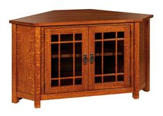 """Amish McCoy Mission Corner TV Cabinet - This beautiful Amish Corner TV Unit will work in any room, even your smallest room! It is specifically designed to fit in a corner so that it doesn't take up valuable room space. It has 3 adjustable shelves to store your media items and a 1"""" thick top to support even the heaviest TV! It is built to order and customizable."""