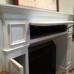 This fireplace mantel has tons of secret storage spots. So cool