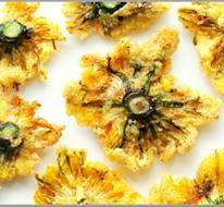 Breaded or Battered Dandelion Flowers. Wash dandelion flower heads & pat dry. Prepare batter --you can find many types of batter – the simple flour & beer batter, or you can try bread crumbs, tempura crumbs or a batter that is later coated with cornflakes or crackers. Spices of choice may be added to the batter mix. Toss the flower into the batter & deep-fry or pan fry. Edible Flowers Foraging Walks, London.