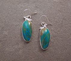 The Depths of Courage earrings, stunning Peruvian opals. https://www.etsy.com/listing/226069084/sterling-silver-blue-peruvian-opal?ref=shop_home_active_1