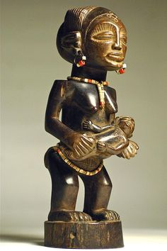 Chokwe Mother-with-child Figure. Angola. 2nd half 20th century. 36cm. Wood, beads, metal. Collection PD-Jipsinghuizen-NL