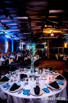 Beautiful blue decor featuring blue uplighting in the Skybox Banquet room at the Metropolis Resort. Photo by [V]Imagery + Design