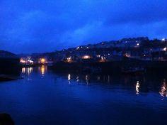 Warm glow, dark harbour. Mevagissey