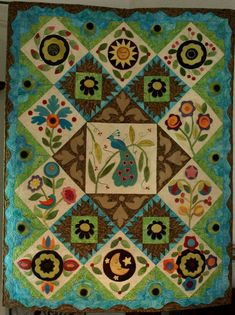 A different version of our favorite wool applique quilt Pennies from Heaven.