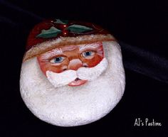 tole painting of a santa claus on a rock