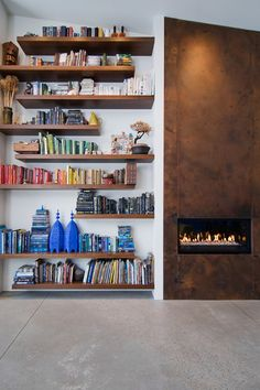 Floating bookshelves, totally filled and not totally lined up... contemporary living room by Lucy Call