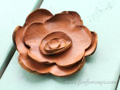 Leather flowers   I am going to make these and put on my boring leather shoes!