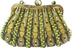 These clutch purses were carried during formal occasions. This type of beading and embroidery was in fashion at that time and were even used on long blouses and shirts. Some of this came back to style today.