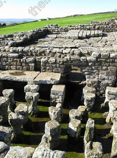 Image of Under floor heating system, Housesteads Roman Fort, Hadrian's Wall, Northumberland, England, UK. Stone pillars supporting   Leslie Garland Pictures