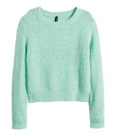 Mint long-sleeved, loose-knit sweater in bouclé yarn.   H&M Pastels