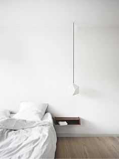 Like the idea of a dim-able, hanging light over the headboard.