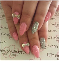 Pink & glitters with a bow design in almond shaped.