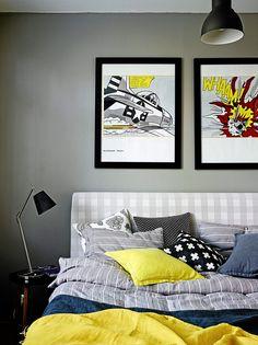 Riinan ja Peltsin makuuhuone jatkaa harmaan rauhallisia sävyjä. Pop-taide on Peltsin mieleen. Harmaa seinämaali on samaa sävyä kuin ruokatilassa.