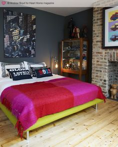 awesome dark wall and love the pops of colour
