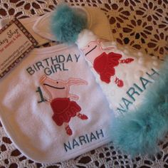 http://www.artfire.com/ext/shop/product_view/sockmonkeyshop/4040324/Olivia_the_Pig_Appliqued_Personalized_First_Birthday_Hat_and_Bib_S/Childrens