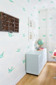 """We love that everyone was on board (however hesitant they were at first) to paper the walls and ceiling with this beautiful whimsical wallpaper from Hygge and West. BTW, it's appropriately called """"Daydream."""""""