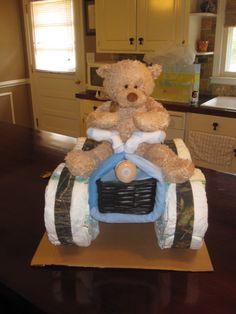 #BritneyEllisor... four wheeler diaper cake i made :)