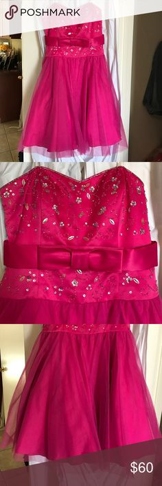 Pink Strapless Cupcake Prom Dress Gorgeous beaded satin and tool strapless prom dress. Only worn once and kept in a garment bag hanging. Above the knee, full bottom with 7 layers. Perfect for Homecoming, Prom, Sweet 16 or a Quinceañera ! Morgan & Co. Dresses Prom