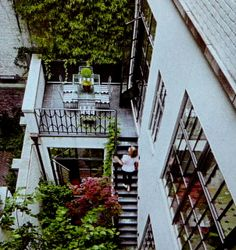 8,500 square feet 8 story New York City dream home.  Greenery courtyard garden on first floor staircase up to breakfast room terrace.