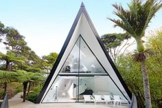 "Chris Tate's bach is known as the ""Tent House"" because of its distinctive shape."