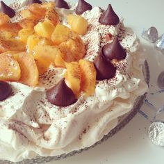 Peaches & Cream Pavlova with Hershey's milk chocolate kisses. Fresh as a summer's breeze!