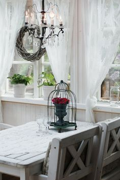I like the flowers in the birdcage centerpiece.