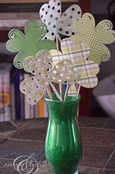 Paper Shamrock Bouquet, Button Shamrock, Lucky Charms Treats, etc. Lots of cute St. Paddy's ideas!