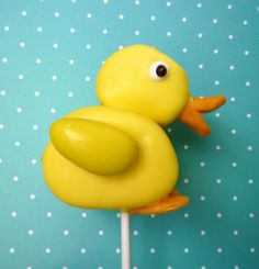 Marshmallow chick pop - jumbo & regular marshmallow on stick and dipped in melted yellow candy, yellow jordan almond for wing, edible eyes, and Starburst cut & formed for feet & beak