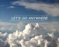 View above the clouds with the text let's go anywhere