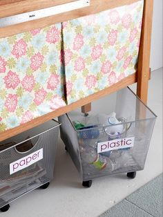 Rolling recycle bins, also a perfect idea for under the butcher block for keeping water bottles tidy