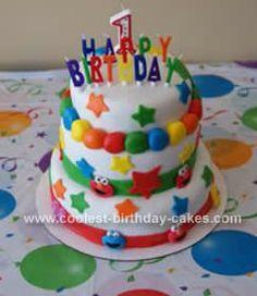Homemade Sesame Street Birthday Cake Design: I made this Sesame Street Birthday Cake Design for my son's first birthday, he loves Elmo. I used marshmallow fondant. Each layer included chocolate cake
