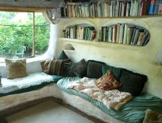 built in book cases in a cob house.. love it