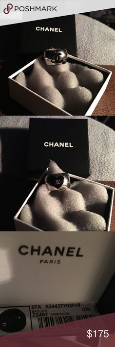 CHANEL Black Enamel-Stainless Steel CC Logo Ring **AUTHENTIC CHANEL ITEM** Simply sleek, this fashionable ring will show your love for Chanel with a black enamel CC logo in the center and on the other side the classic CC logo with a heart.  The ring is in pristine condition-rarely worn. Purchased on impulse at Chanel store in Highland Park Village in Dallas, TX. In original box with bar code & serial number sticker inside to guarantee authenticity. I only buy/wear authentic products. Feel…