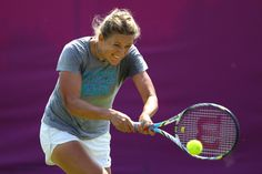 Victoria Azarenka of Belarus returns the ball during the practice session ahead of the 2012 London Olympic Games at the All England Lawn Tennis and Croquet Club in Wimbledon on July 26, 2012 in London, England