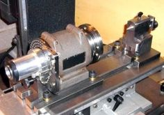 Index Fixture - Homemade index fixture constructed from steel casting, lathe spindle, tailstock, collets, and bearings. Capable of 20, 200, and 360 divisions.