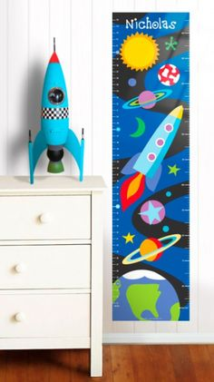 Out of This World Personalized Wall Decal Growth Chart  -Little astronauts will enjoy rocketing to new heights with this Out of this World personalized growth chart! They'll love seeing their name featured in this space scene with a launching rocket, shooting stars, planets and their very own UFO! This fun growth chart is ready to hang and will instantly make an exciting change in your kids bed or play room $39.99