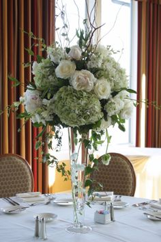 """I like the height of this, plus the more """"naturally"""" assembled bouquet, rather than the typical flower snowballs. Obviously with some purple and white in there."""