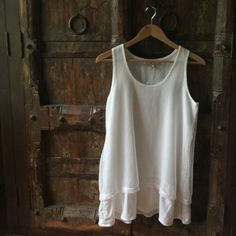Boutique Purchased Tank Top Super cute tank NWT. It's long enough to wear with leggings but also cute with jeans. Small hint of sparkle but not over powering.  Non smoking home. Size s/m. Tops Tank Tops