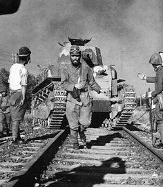 Japanese Army by dani1944. Tank commmander guiding a type89 medium durinng a railway crossong in China 1938.