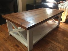 Beautiful farmhouse breadboard style top coffee table with lower shelf. Will take custom finishing request for different paint color or stain