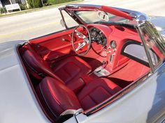 1966 Corvette Stingray Convertible Red Interior in absolutely mint shape - read the full story behind this gorgeous car only at VintageScores.com...